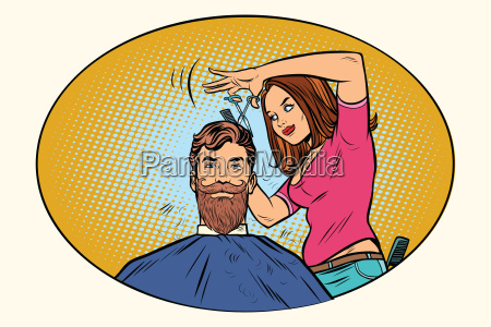 woman hairdresser cuts the bearded hipster