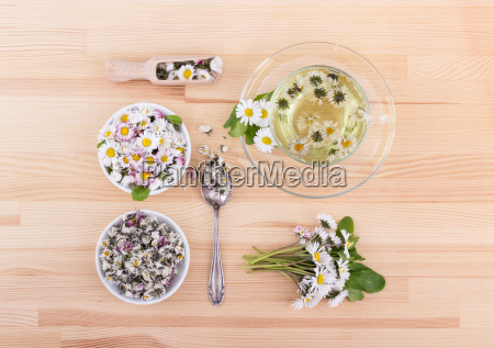 tea with fresh and dried daisies