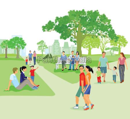 stadtpark im sommer mit familien bei