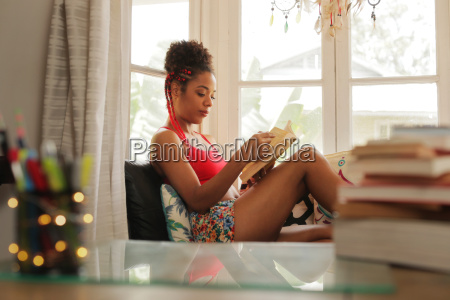 african american woman reading book at