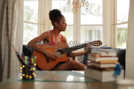 mixed race girl singing and playing