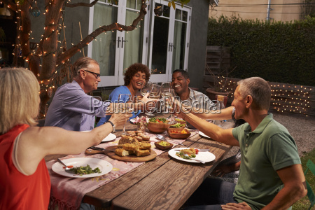 group of mature friends enjoying outdoor