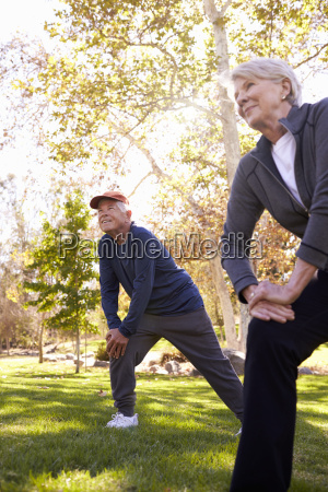 senior couple stretching whilst exercising together