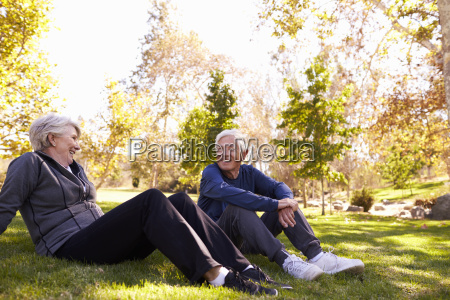 senior couple resting after exercising in