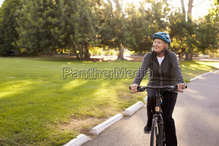 front view of senior woman cycling
