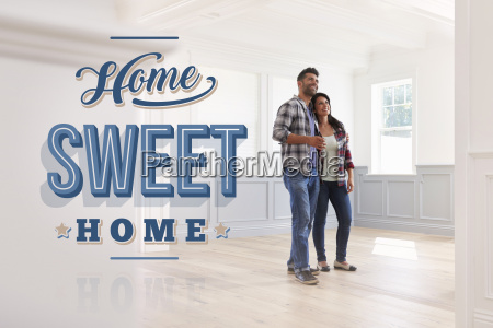 hispanic couple in their new home
