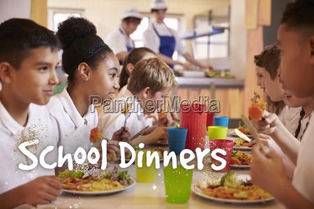 primary school children eat school dinners