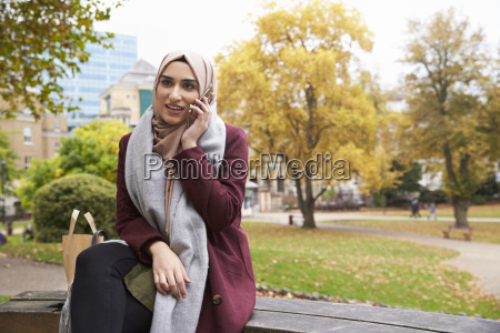 british muslim woman on break using