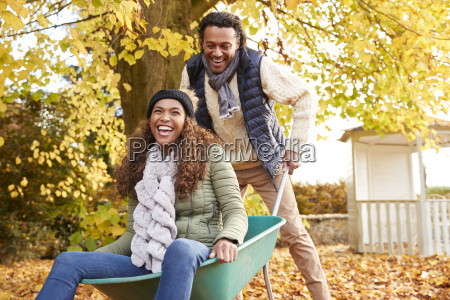 man in autumn garden gives woman