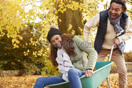 man in autumn garden gives woman