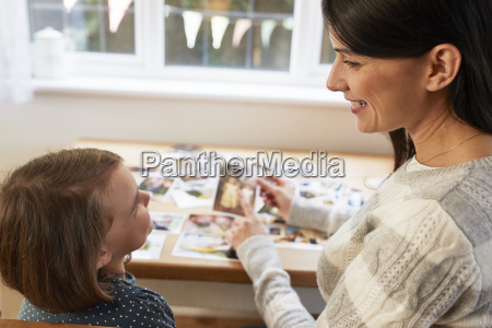 mother and daughter sitting at table