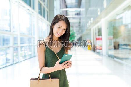 young woman enjoy shopping and using