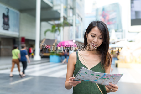 young woman looking for the city