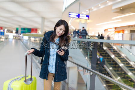 woman go travel and using cellphone