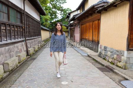 young woman walking in kanazawa city