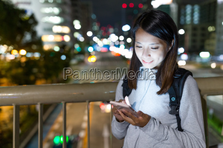 woman using cellphone in nagoya city