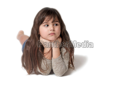 little girl is lying and is