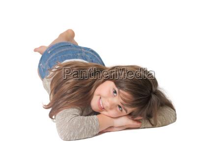 smiling little girl is lying