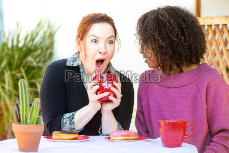 excited couple at restaurant sharing secrets