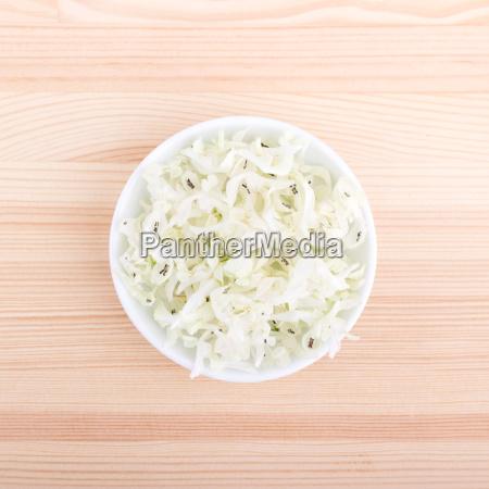 bowl of fresh white flowers of