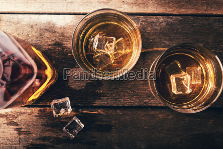 whiskey with ice on old dark