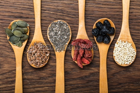 superfoods in wooden spoons