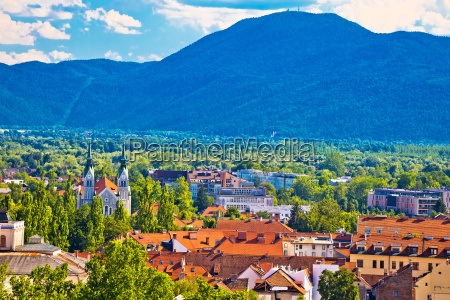 ljubljana green city and mountains background