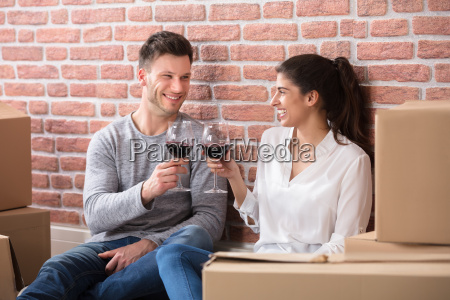 couple toasting wine glasses in their