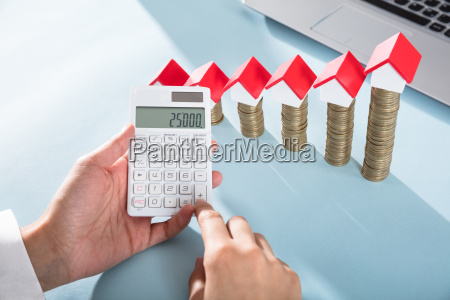 person showing profit on calculator