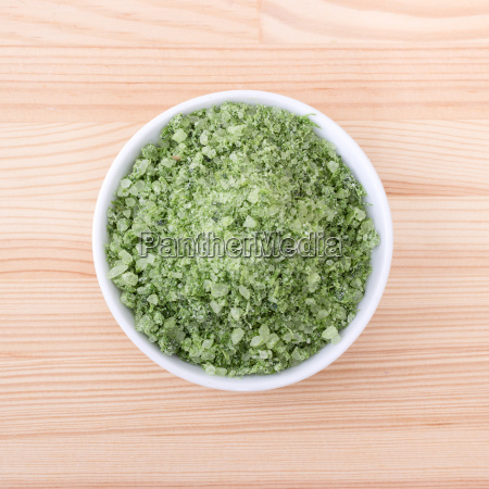 porcelain bowl with green herbal salt