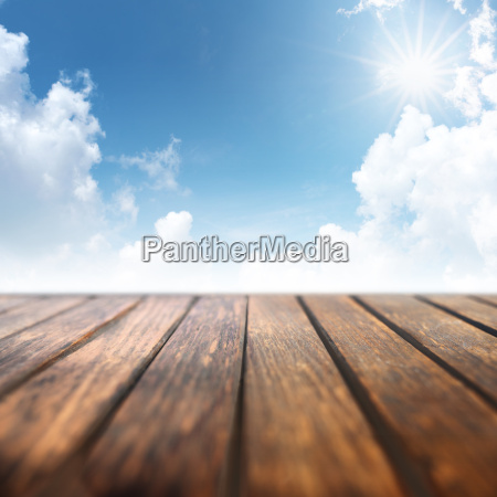 blue sky with wooden table