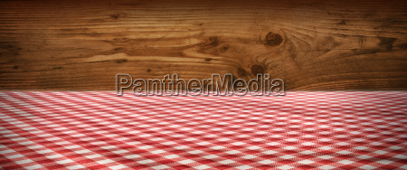 tablecloth checkered in front of wooden