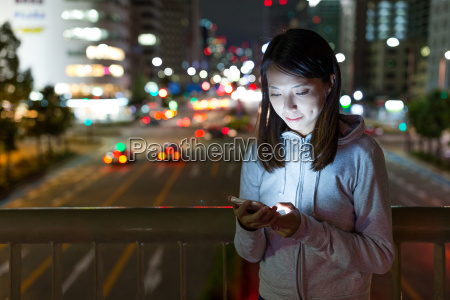 young woman using mobile phone in