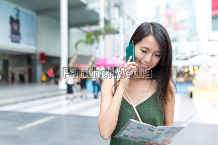 woman asking the direction by cellphone