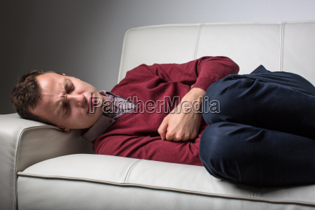young man suffering from severe belly
