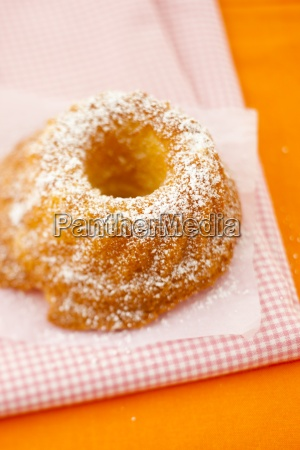 a small guglhupf with icing sugar