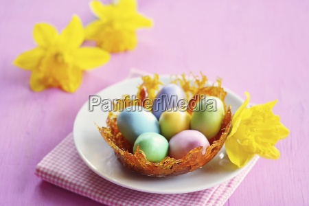 a caramel nest with colourful sugar