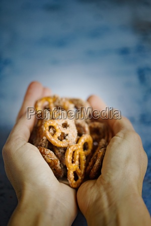 hands holding crunchy sugar and cinnamon