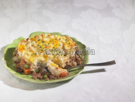 a plate of beef and vegetable