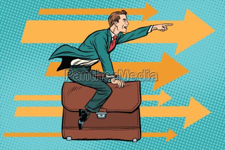 geschaeftsmann fliegt auf eine leder business