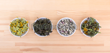 bowls of various dried herbs