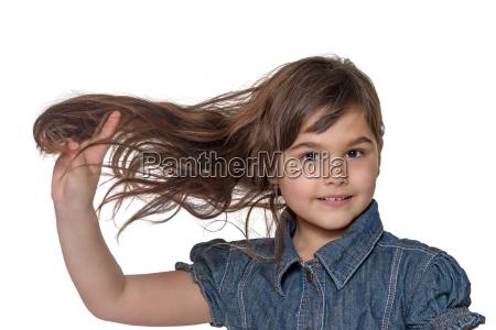 portrait of little girl holding her