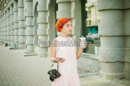 girl talking on the phone drinking