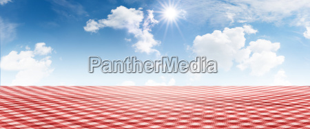 red checkered tablecloth with summer sky