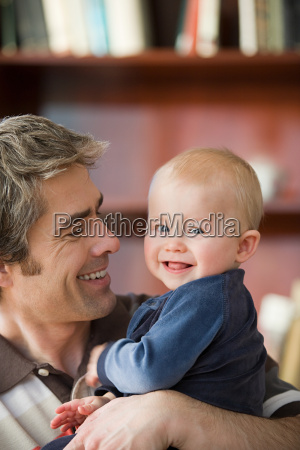 father holding his son