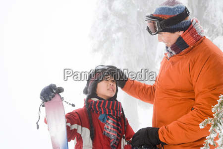 father and son with ski