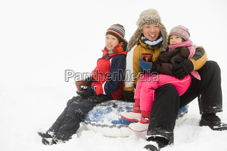 father and kids having warm drink