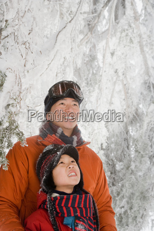 father and son in snow