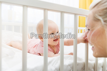 mother playing with her baby in