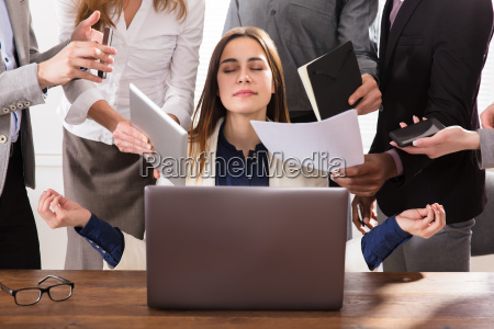 hard working businesswoman meditating